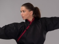 Phoenix Kung Fu jaka melna ar sarkanu apkakli